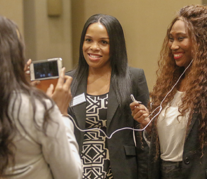 Gloria Agbogla, right, interviews judge Aiesha Redmond at the Democratic watch party on Nov. 6.