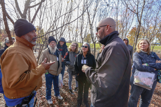 Matt Grubisich, right, leads a tour of the tree farm during the Sustainability Summit Nov. 9.