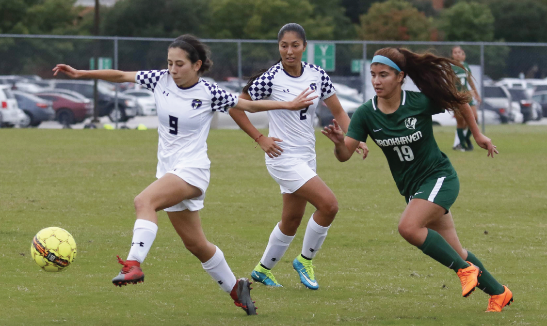 Ibarra, left, takes players on and dribbles away from a Brookhaven defender on Oct. 22. The Richland women's team won the NJCAA Div. III national championship this year.