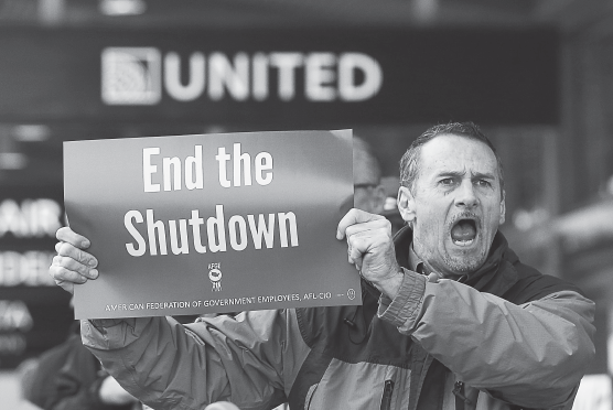 Several dozen federal employees and supporters demonstrated at the Sacramento International Airport calling for President Donald Trump and Washington lawmakers to end the partial government shutdown, Jan. 16, in Sacramento, Calif.