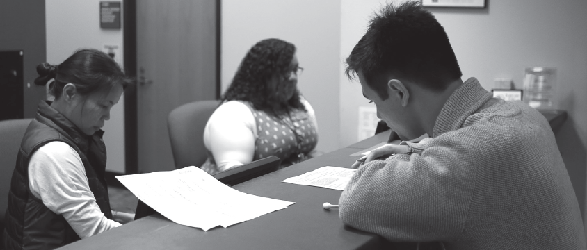 Kyle Chainey, right, talks with Vinhty Dinh and Jacqueline Smith in the admissions office at Thunderduck Hall on Jan. 18.