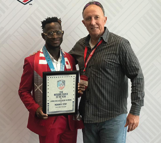 James Sesay, left, and Sean Worley are honored at the United Soccer Coaches convention.