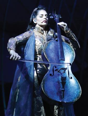 Queen and shaman Prospera plays cello.