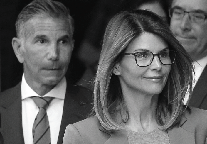 Lori Loughlin, and husband, clothing designer Mossimo Giannulli, left, depart federal court in Boston after facing charges in a nationwide college admissions bribery scandal.