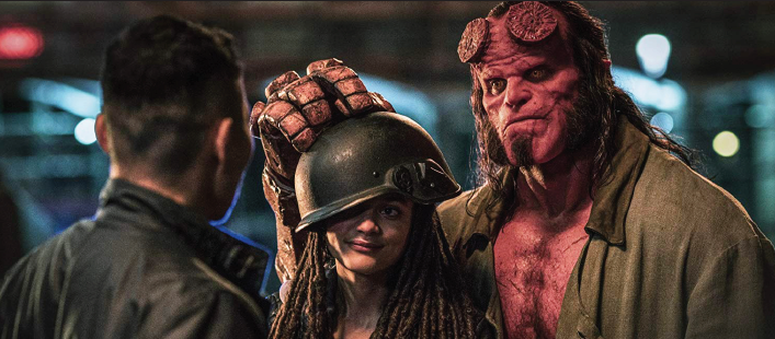 Actors Sasha Lane and David Harbour as Alice Monaghan and Hellboy.