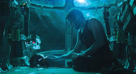 """Tony Stark (Robert Downey Jr.) looks at his mask in """"Avengers: Endgame."""""""