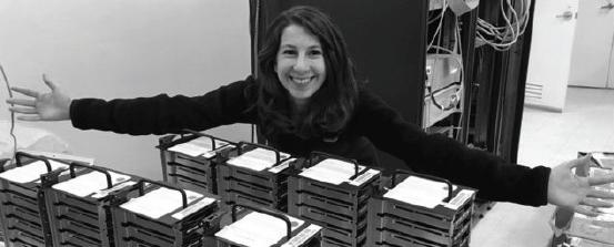 Dr. Katherine Bouman displays her hard drives.