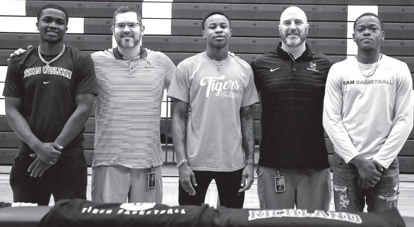 Davon Berry, left, Coach Brian Graham, Caleb Williams, Coach Jon Havens and David Shepard at signing day on April 30.