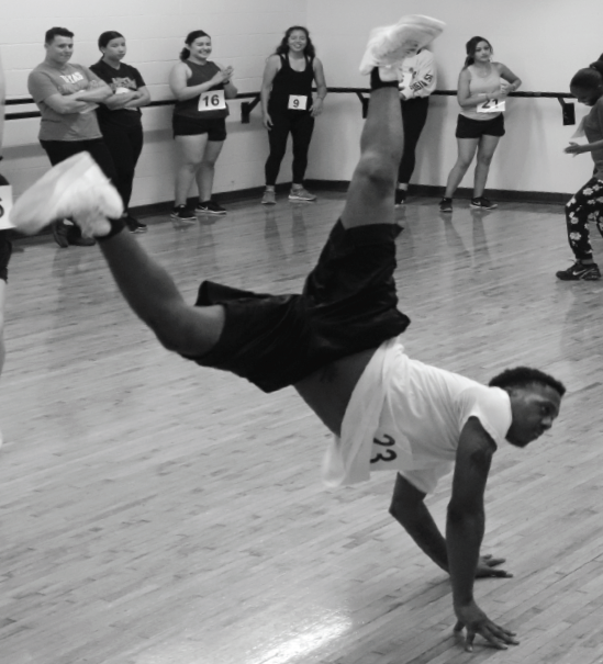 Justin Akers does a handstand and a kick-flip during auditions.