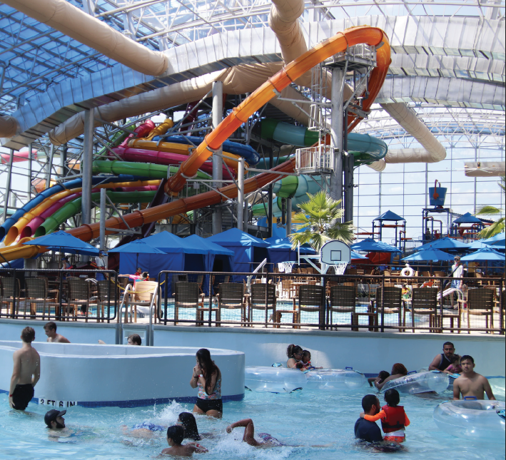 Guests splash and slide around at the Epic Waters Indoor Waterpark
