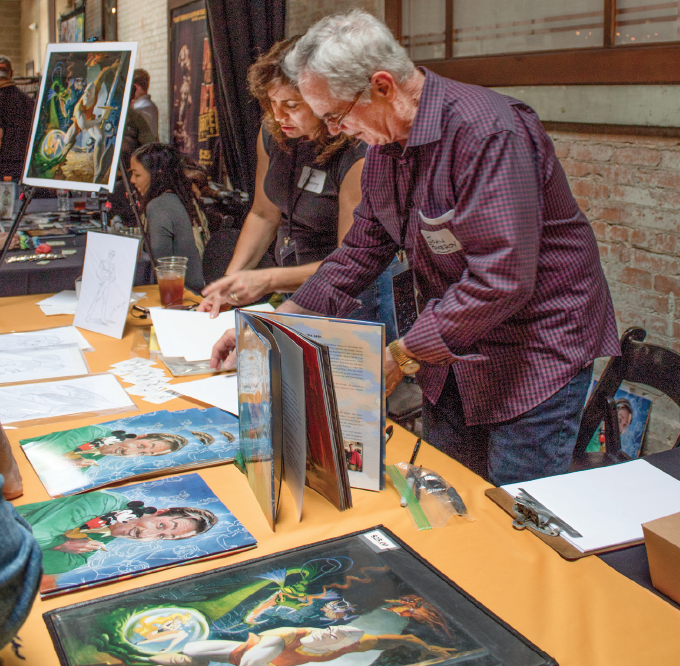 John Pomeroy displays his work in the Artist's Alley at Industry Giants 2019.