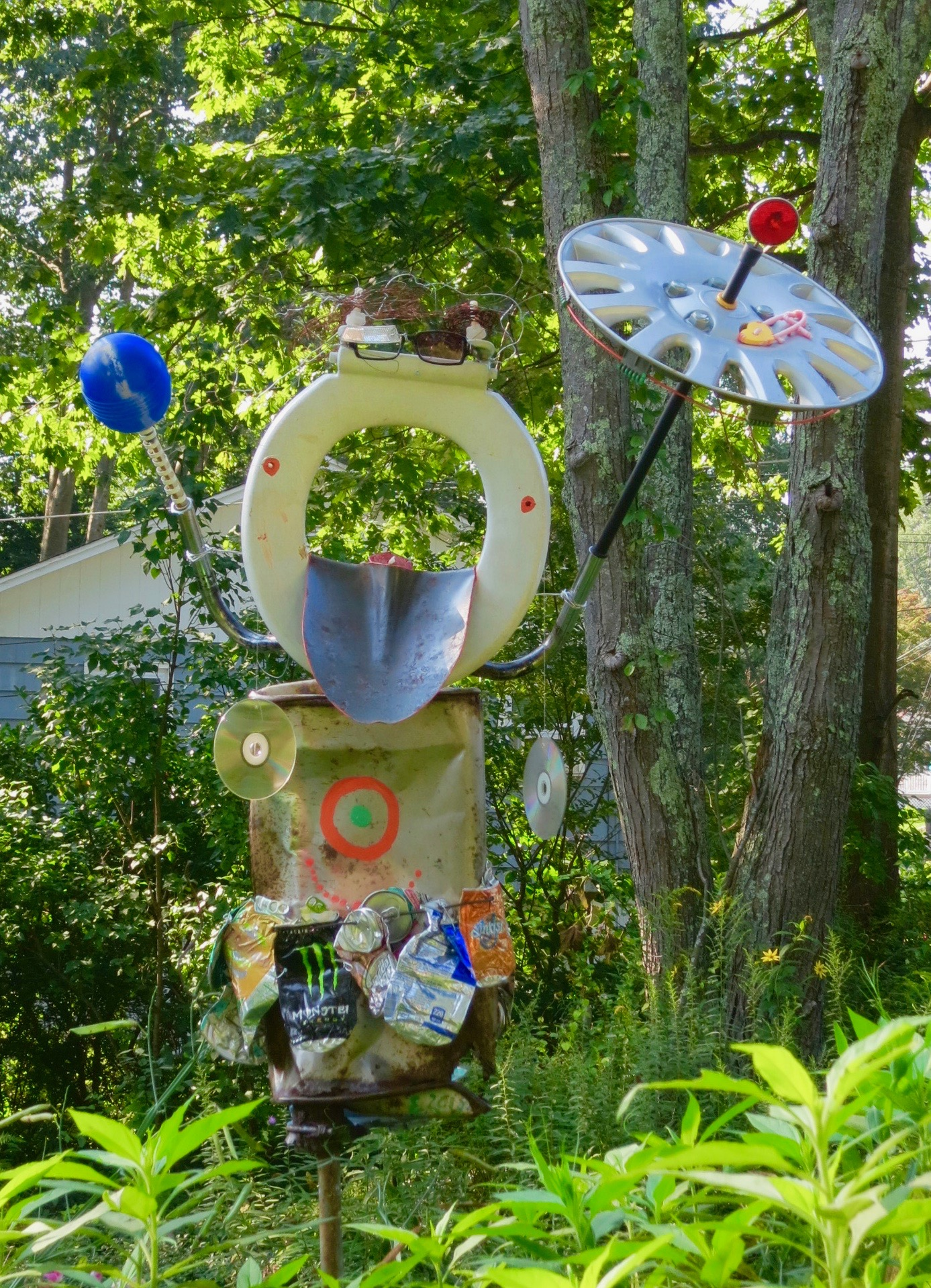 I don't mind snow, wind, sun or rain, 6 foot outdoor sculpture of found and repurposed objects