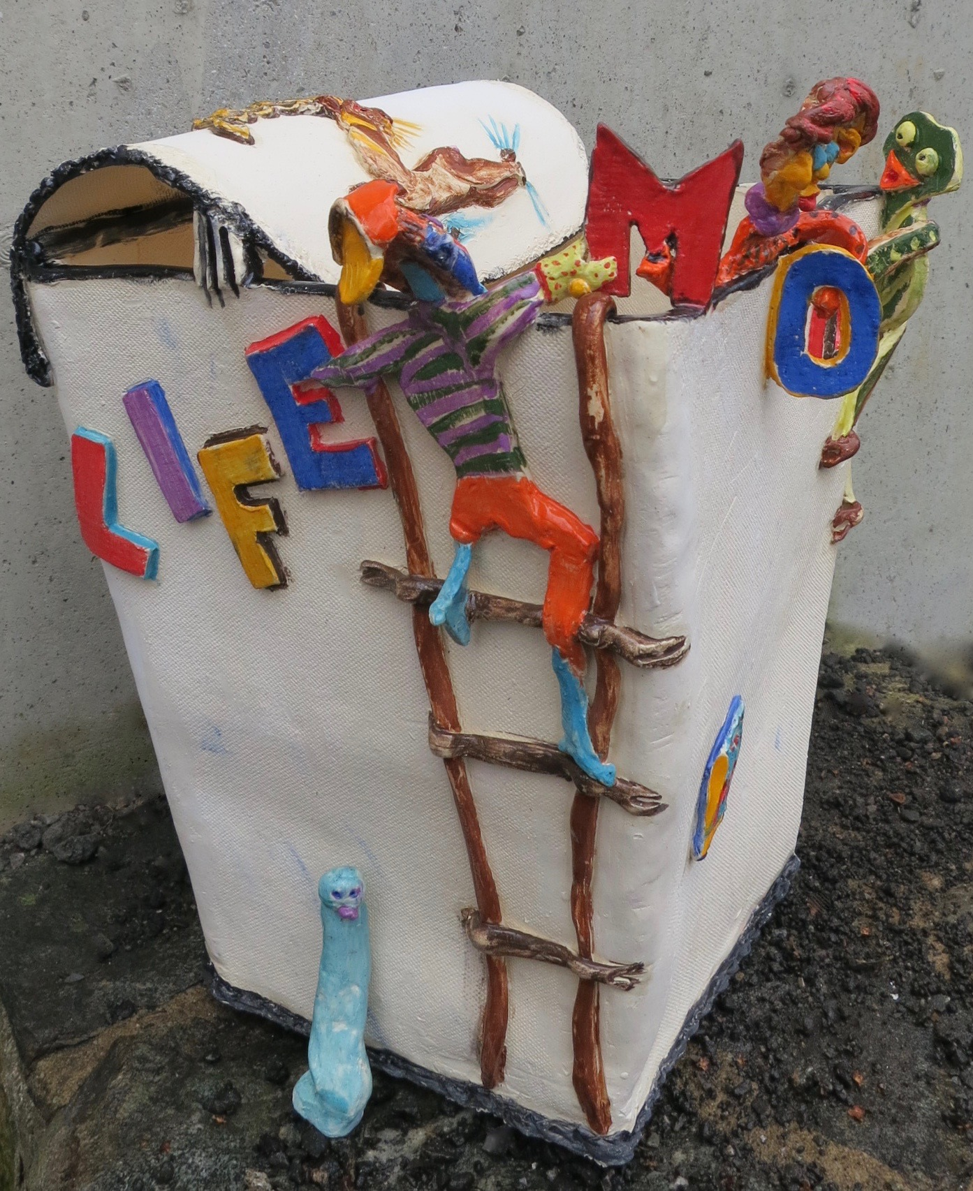 Modern Times, a one foot ceramic garbage pail  and pals, with it's spirit outside(made by my grandson)