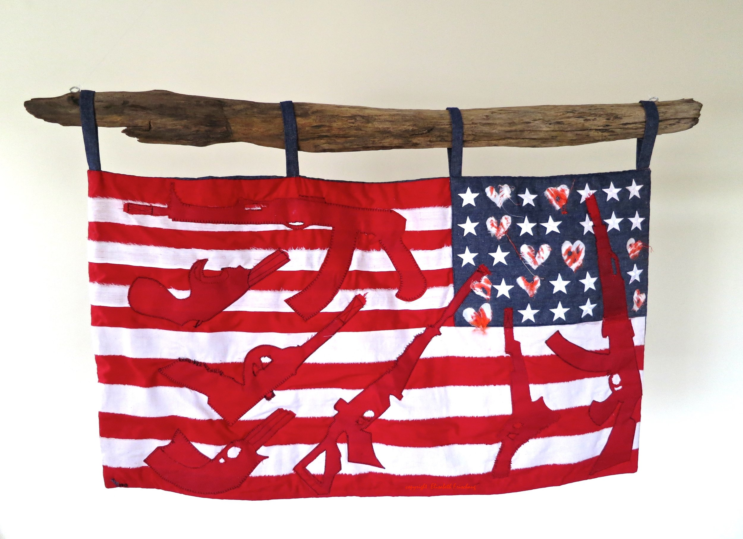 """America Under Gun, quilted mixed media flag, 33"""" across x 45"""" long, featured in the Nation and widely shown, it remains timely with more and more mass shootings"""