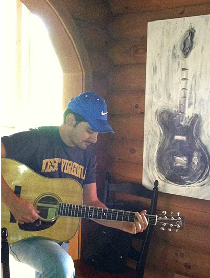 Brad Paisley in his kitchen with his Hendon painting