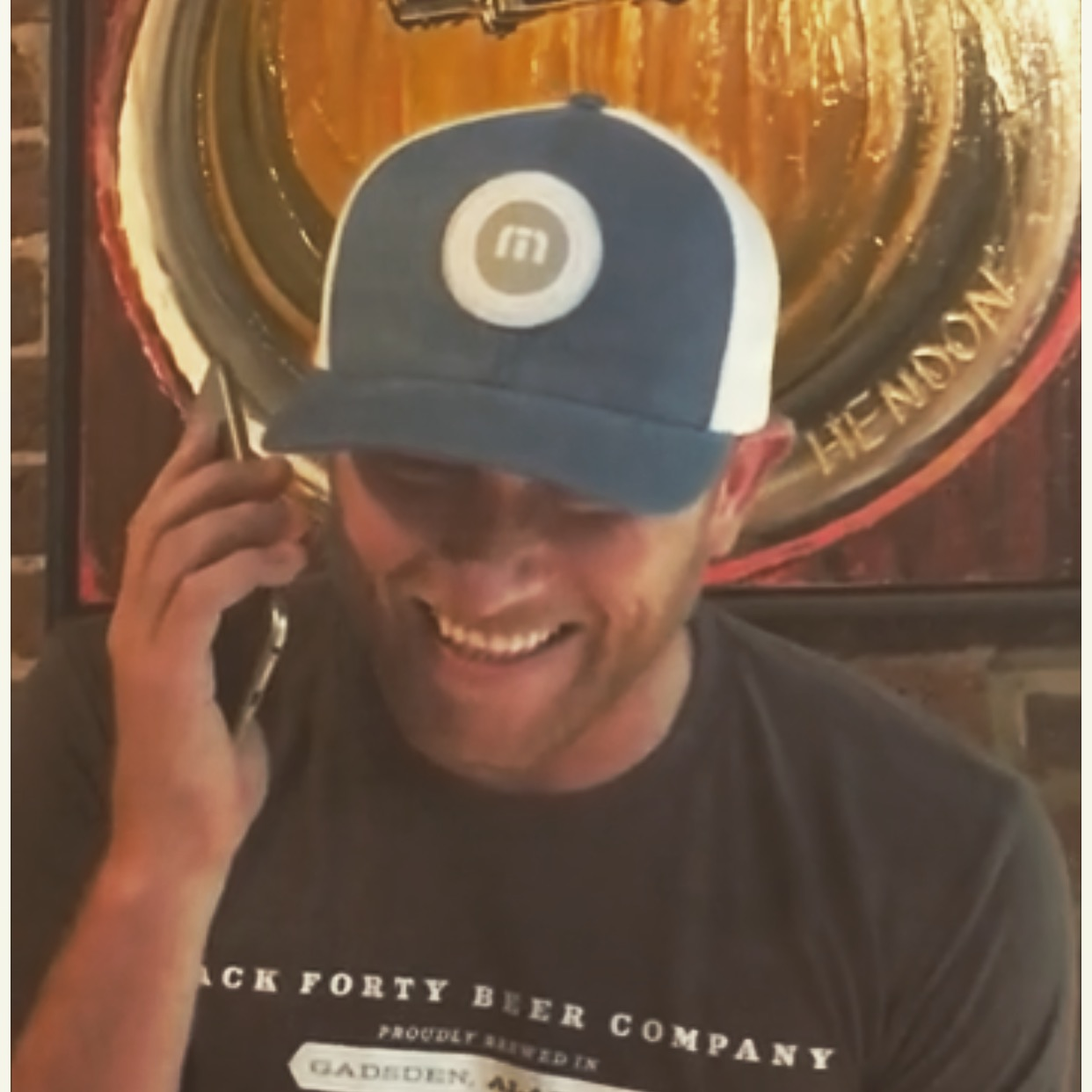 Cole Swindell calling fans in front of his Hendon painting