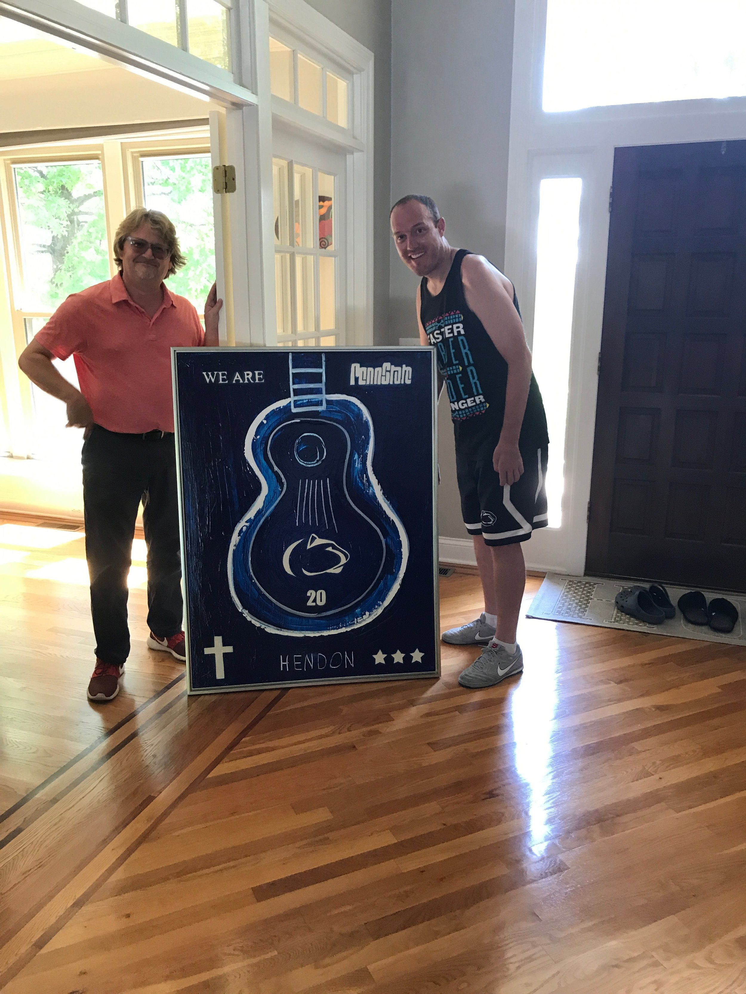 ALS Foundation Champion Tim Shaw with his custom PennState Hendon painting