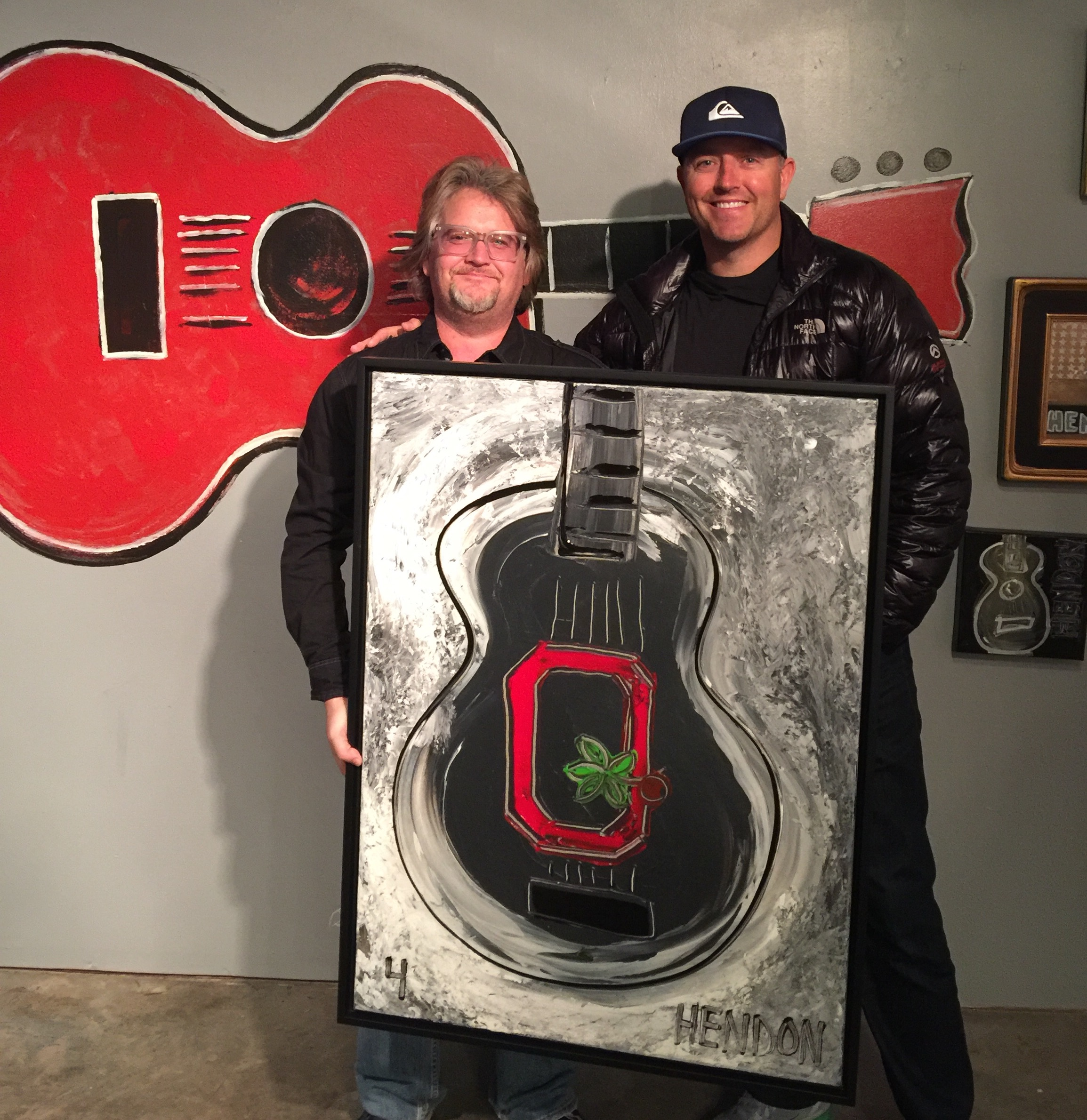 Former OSU quarterback and current college football analyst Kirk Herbstreit picking up his Hendon painting, January 2017.