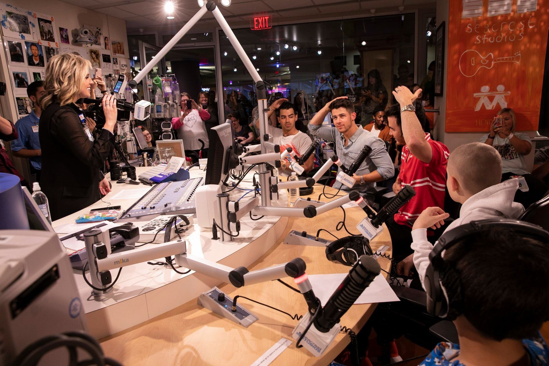 Jonas Brothers at Seacrest Studios with Rob's Painting Featured