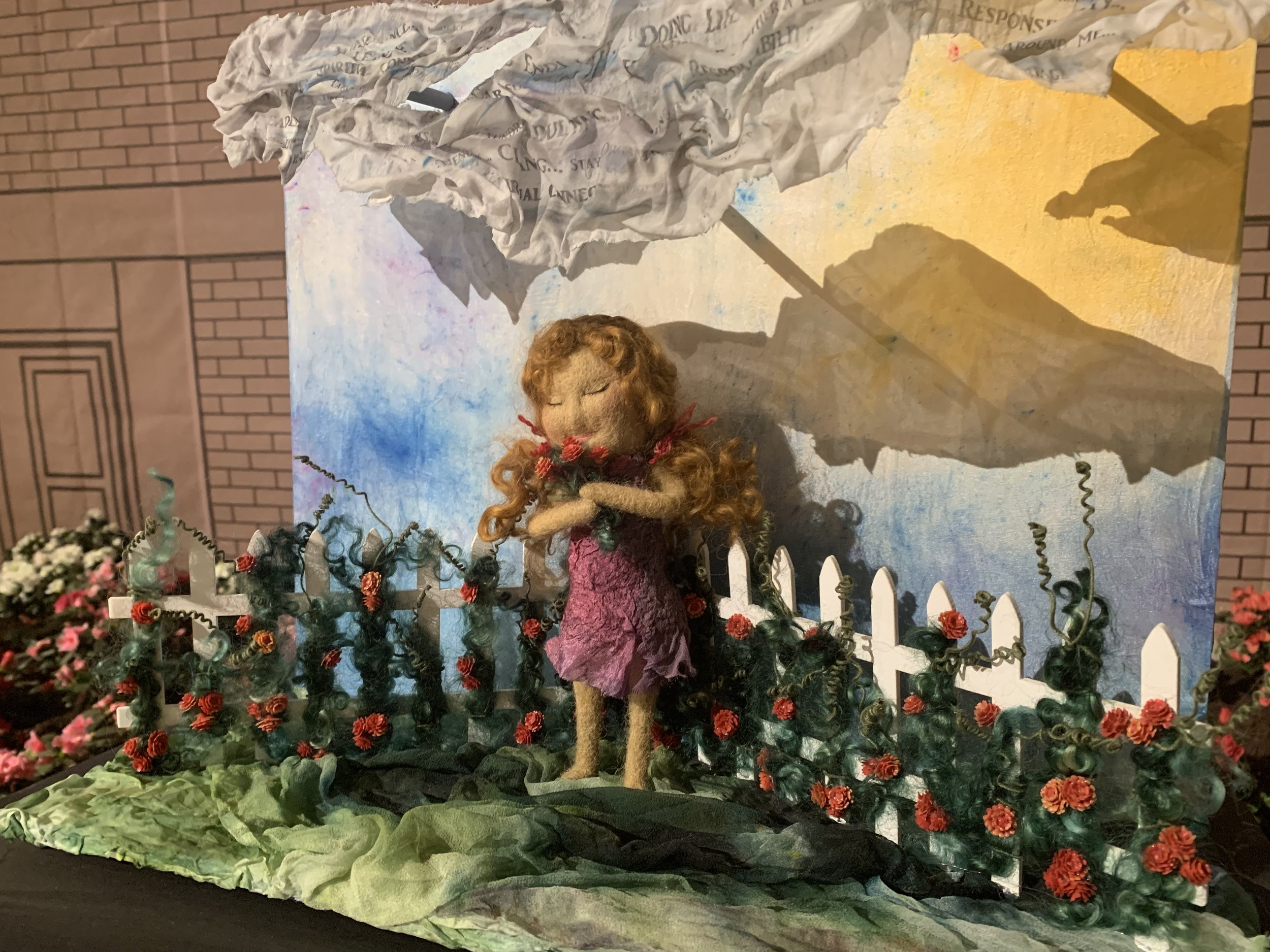 The art piece by Natasha Lehrer Lewis made me pause. Perhaps not to smell the roses, but to consider how I'm trying to balance the storm clouds and life's demands with more opportunities to feed my creative soul.