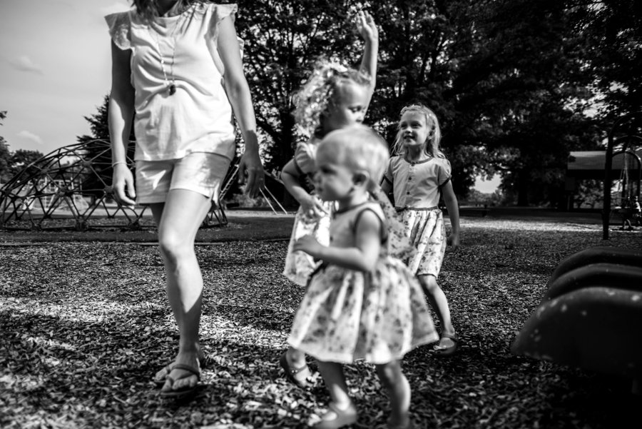 mom and three girls at the playground