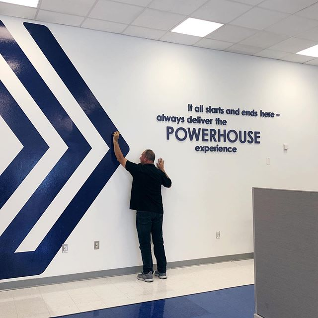 If our walls could talk...as we continue to settle into our new corporate headquarters, environmental branding with bold, fun and powerful messages are going up to showcase our commitment to our associates and our clients