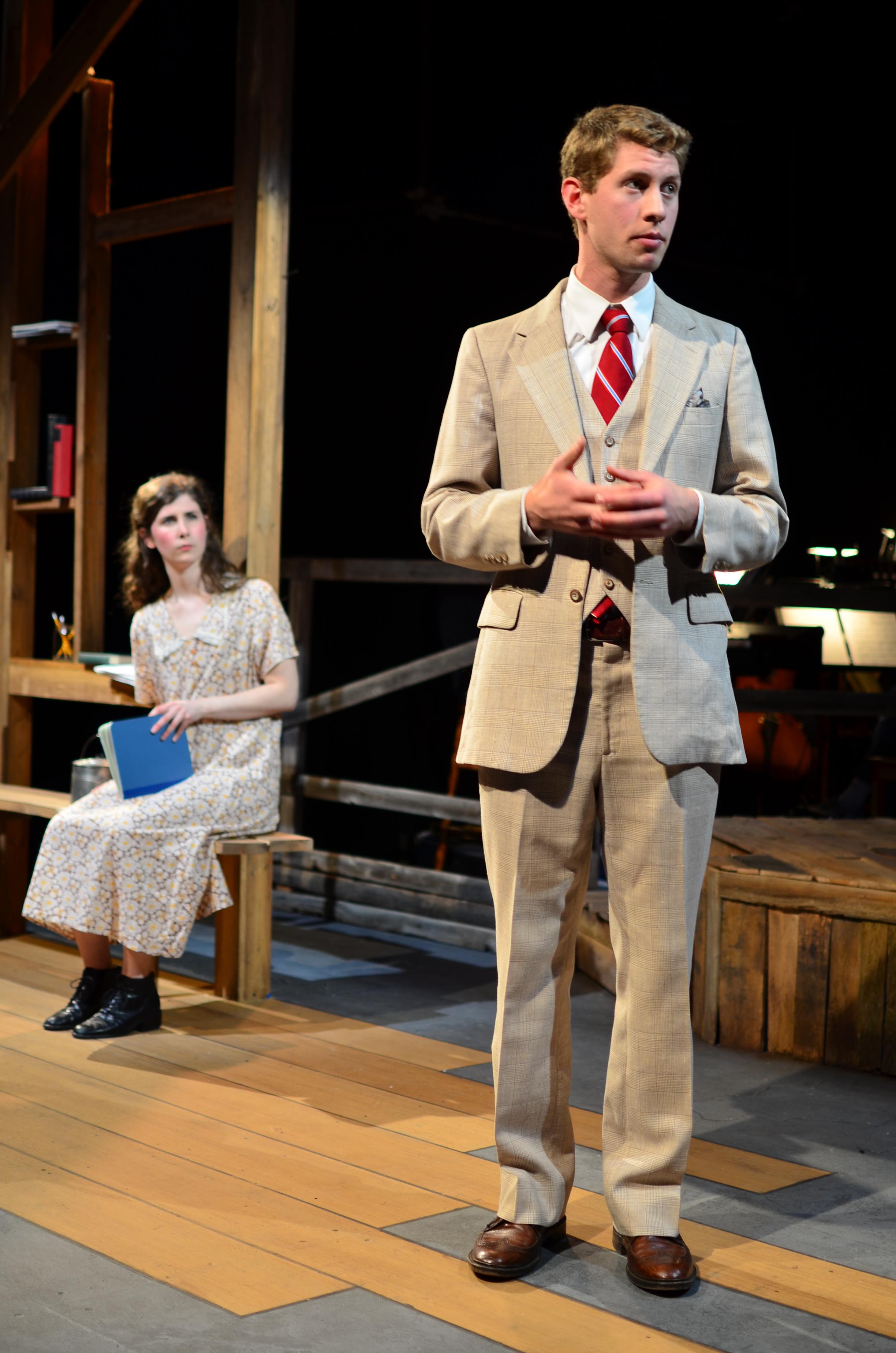 George ( Brandon Levin ) [ foreground ]; Orlena ( Laurel Durning-Hammond ) [ background ].