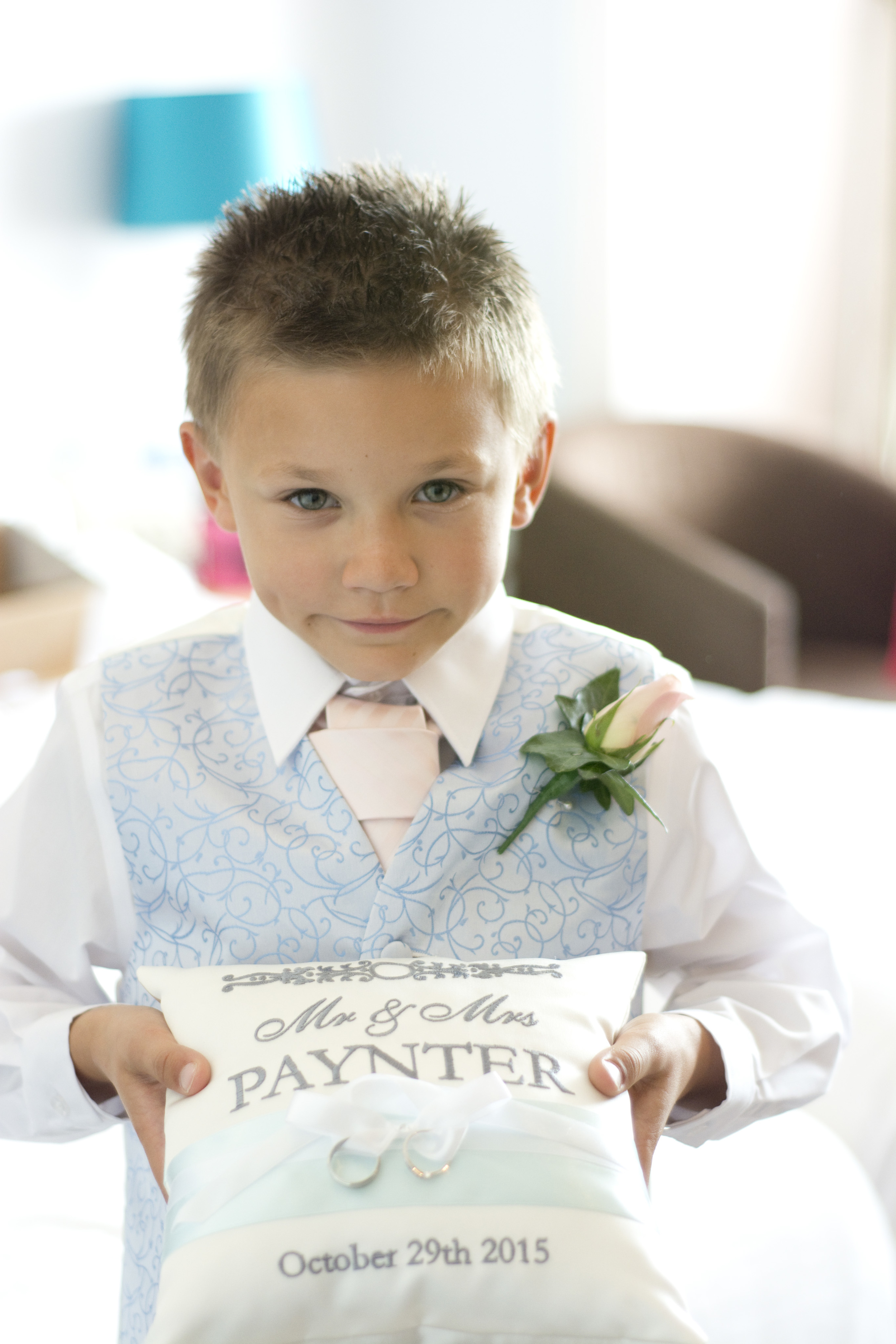page boy holds the ring cushion at The GreenBank Hotel Falmouth