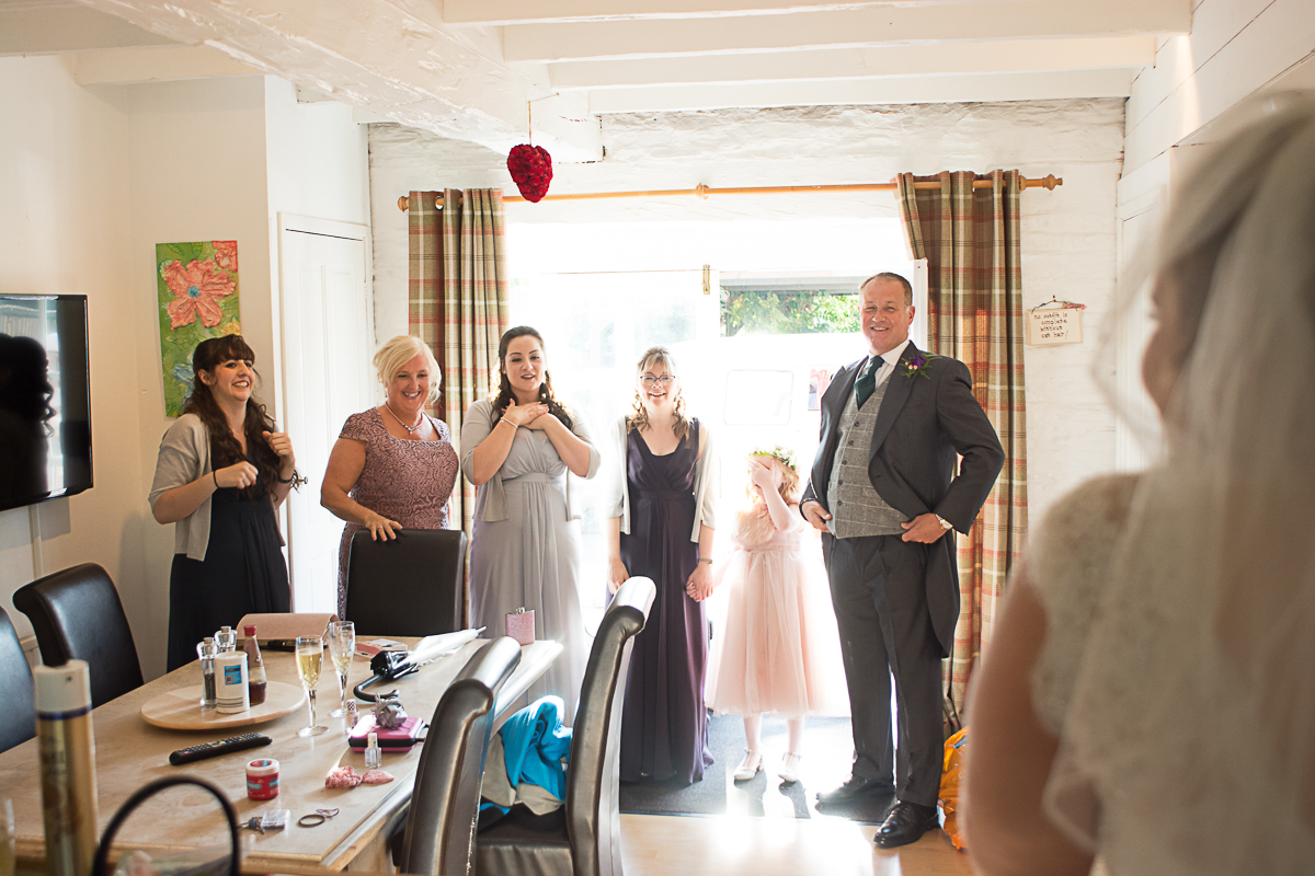 family reaction to bride in her dress