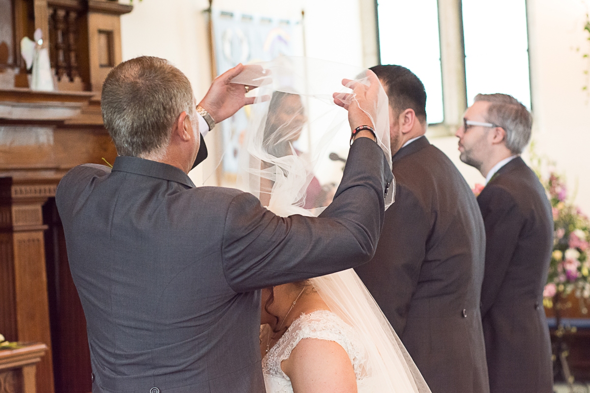 dad lifts his daughters veil at porthleven church