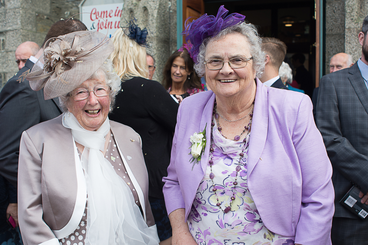 two grans smile outside church in Porthleven