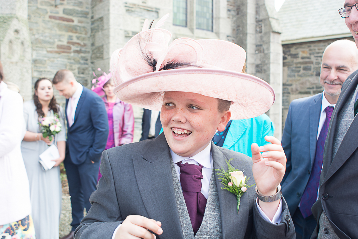 The brides brother wearing his mums hat outside church at Porthleven