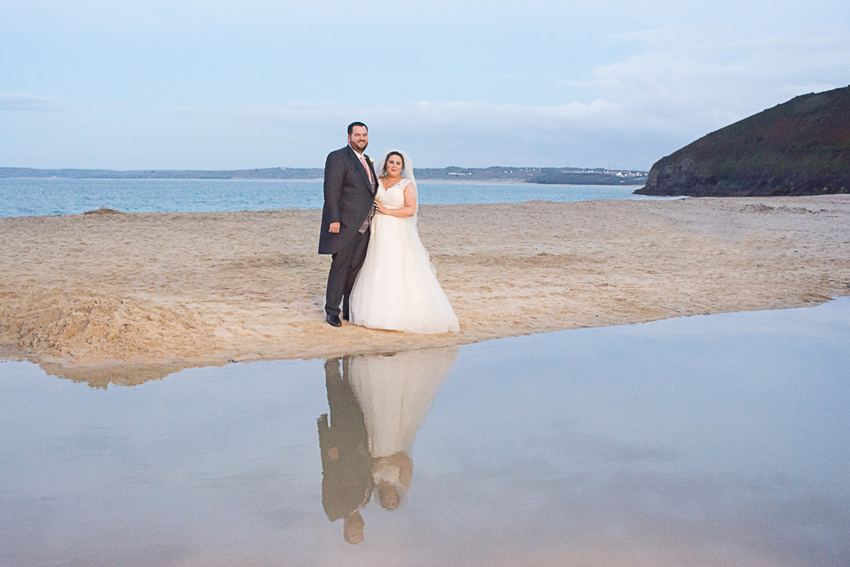 bride and groom water reflection on Carbis Bay beach cornwall
