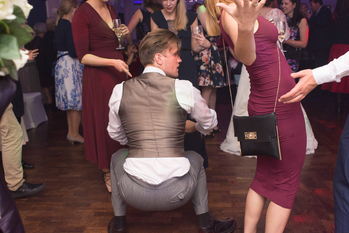 throwing some shapes at a whitsand bay fort wedding