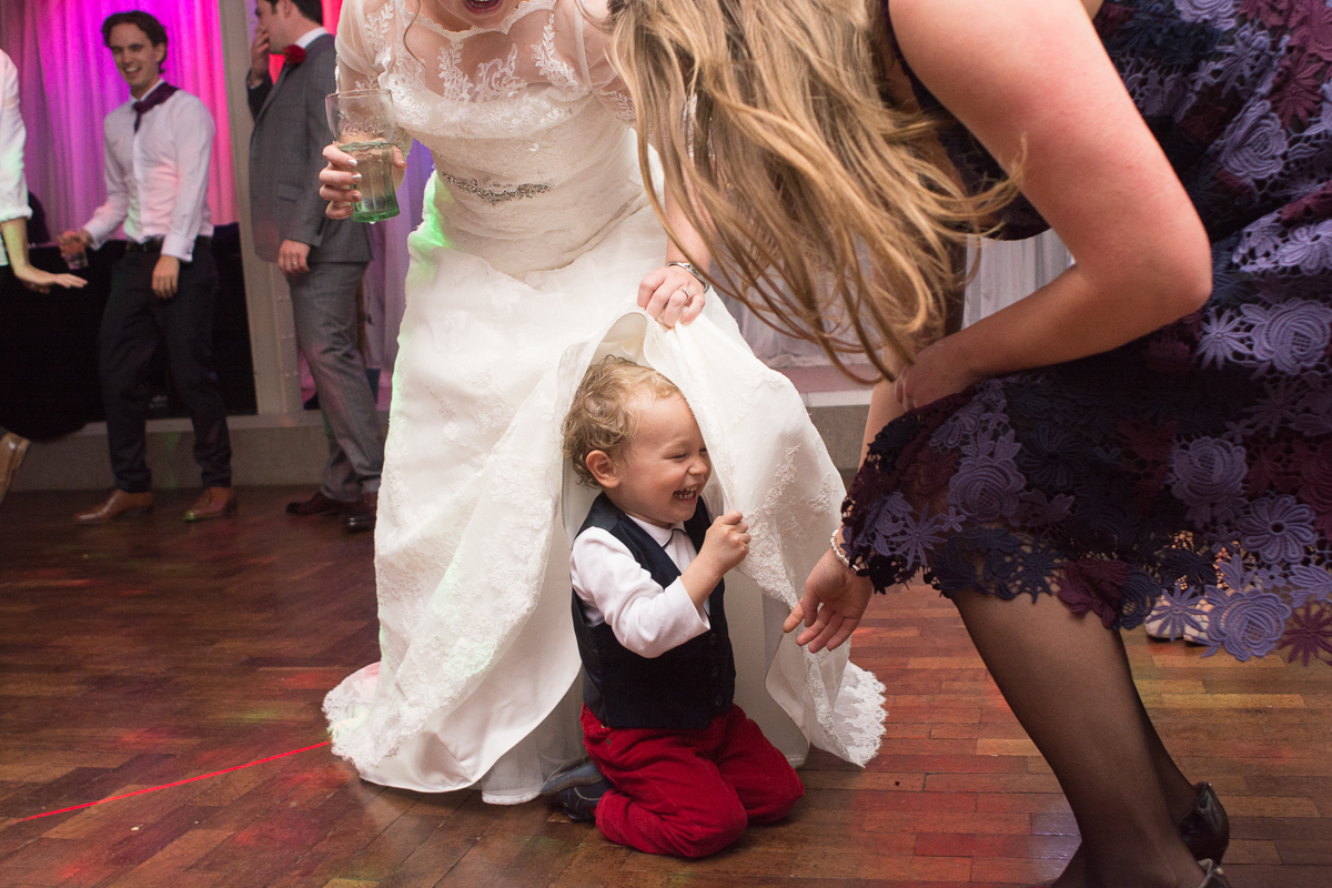 pageboy under brides dress at the whitsand bay fort