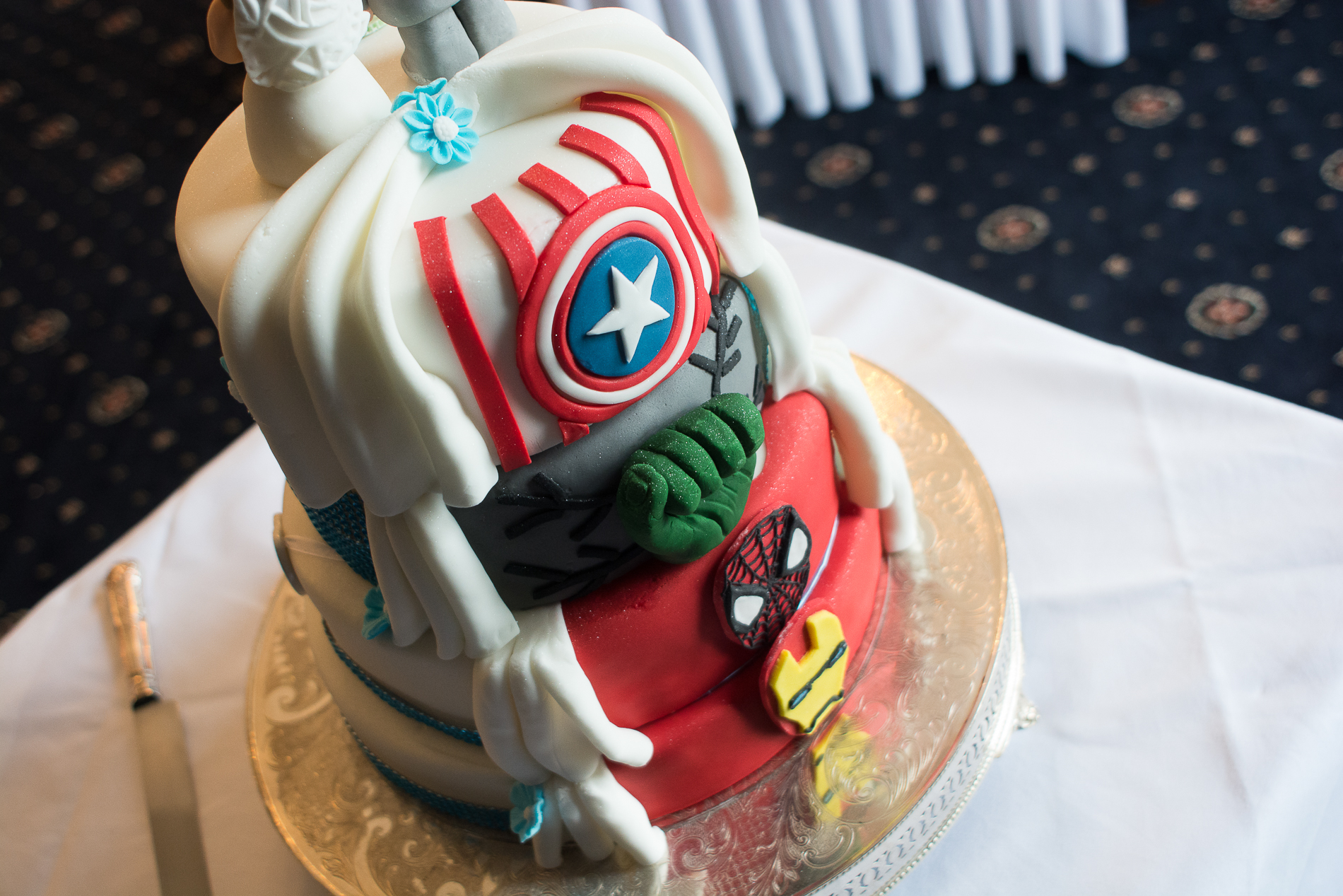 awesome wedding cake with a hidden marvel theme at the back