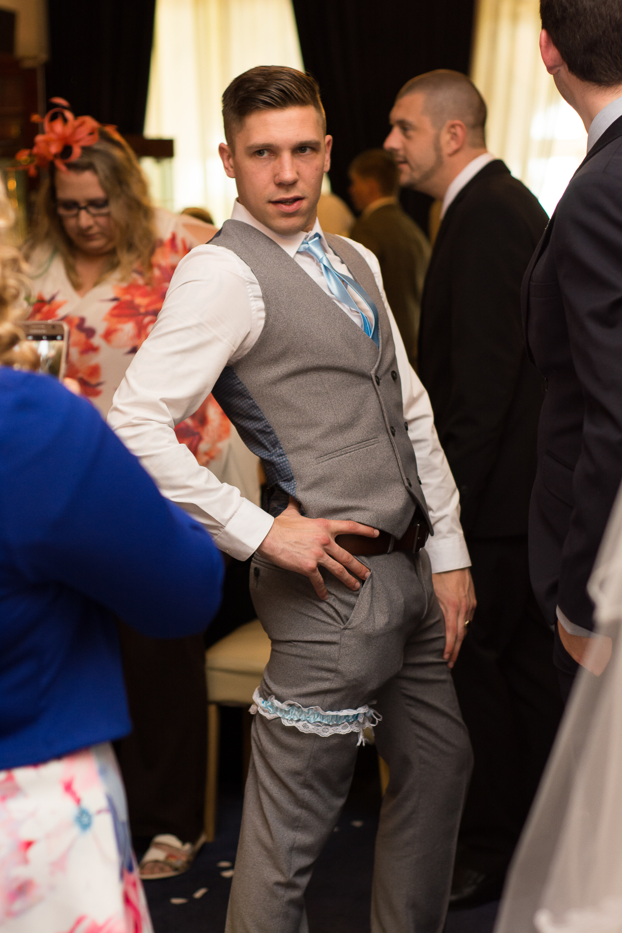 the groom tries on the garter and works it at the atlantic hotel newquay