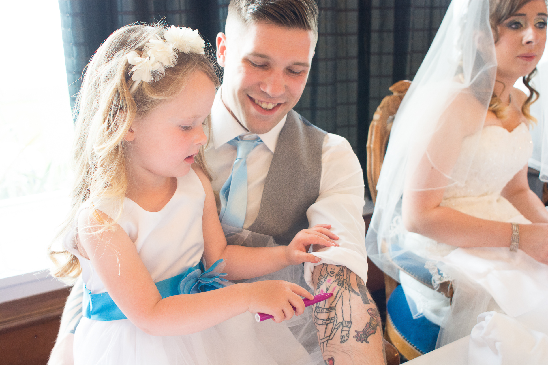 flower girl colours in the grooms tattoos at the Atlantic Hotel Newquay