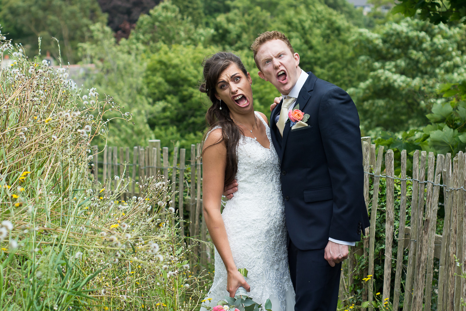 silly faces at their plymouth wedding