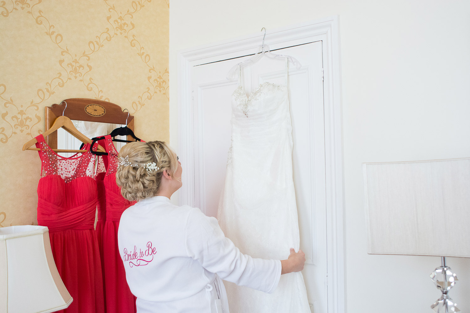 the bride gets her wedding dress down at the Headland Hotel Torquay
