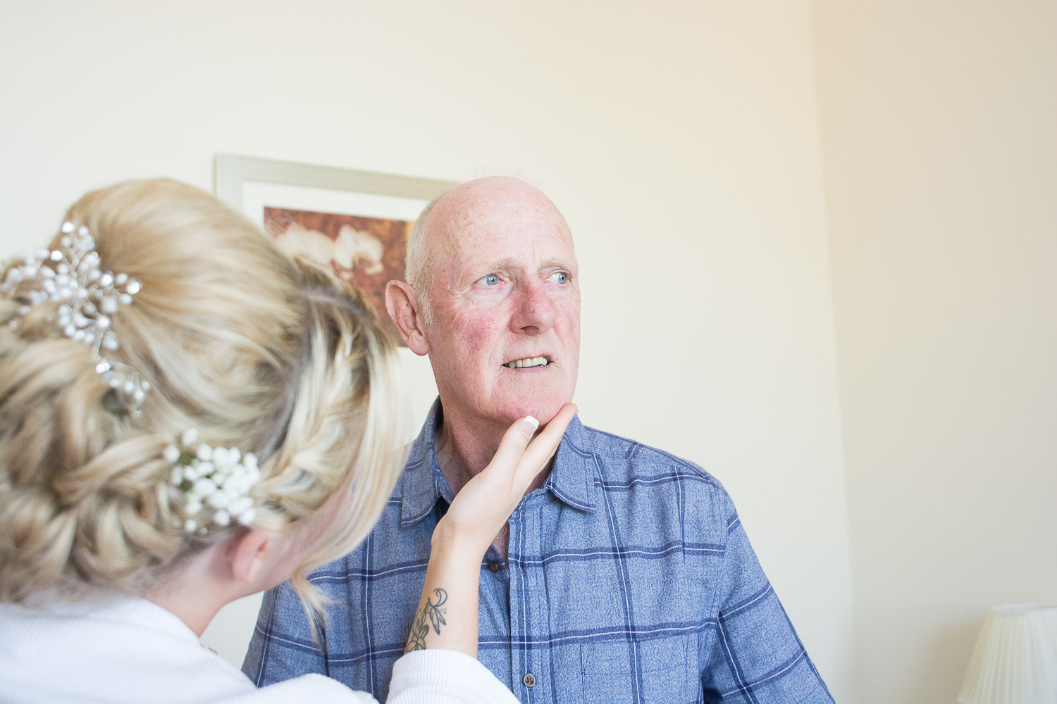 the bride feels how smooth her dad's face is after his shave at the Headland Hotel Torquay