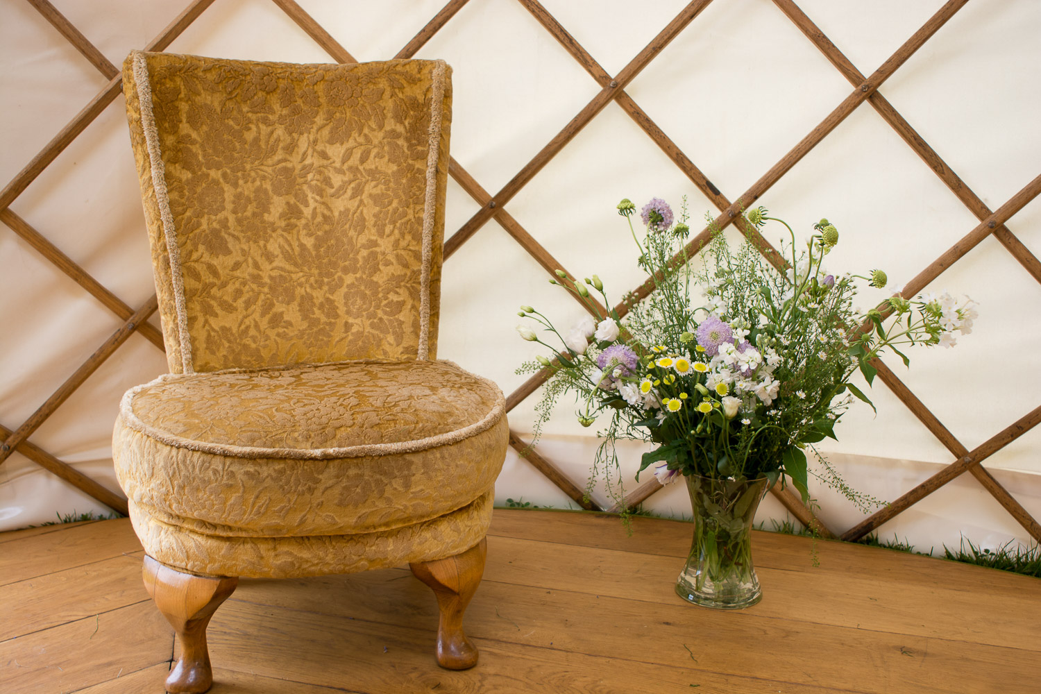chair and flowers, beautiful details at wedding yurts wedding in leicestershire