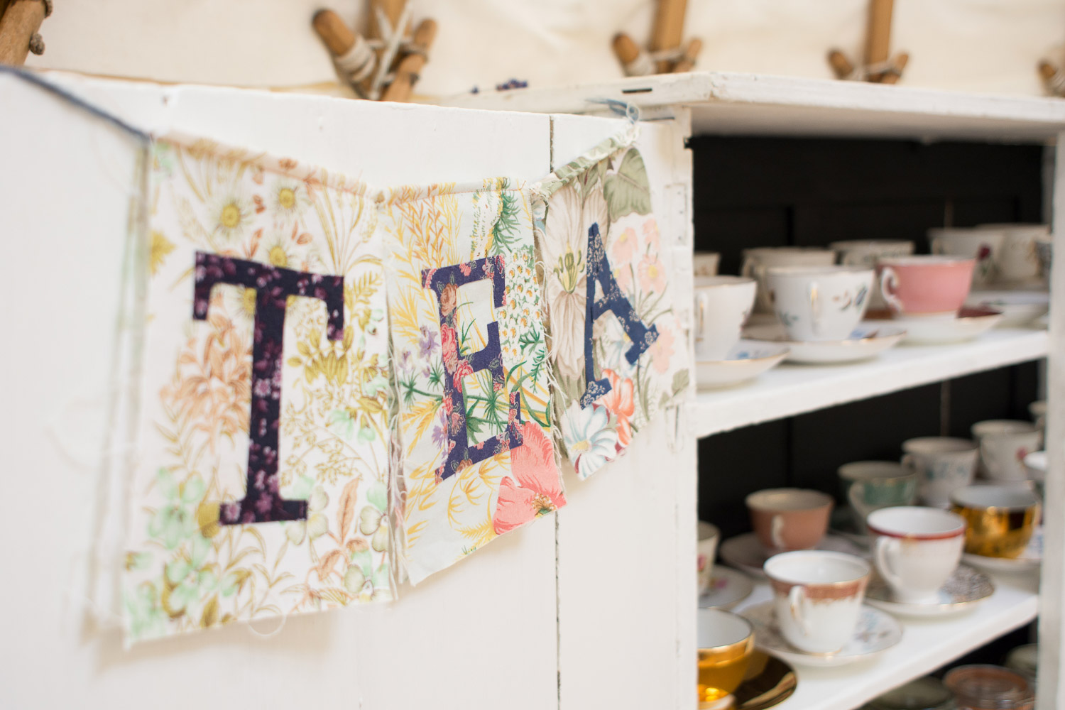 Tea station with classic cups and saucers at wedding yurts wedding in leicestershire
