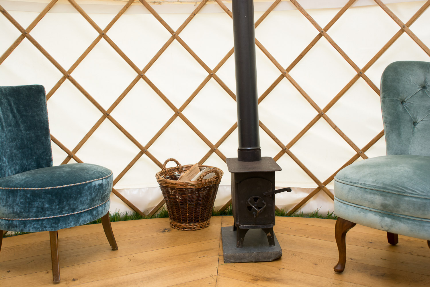 chairs and log burner at wedding yurts wedding in leicestershire