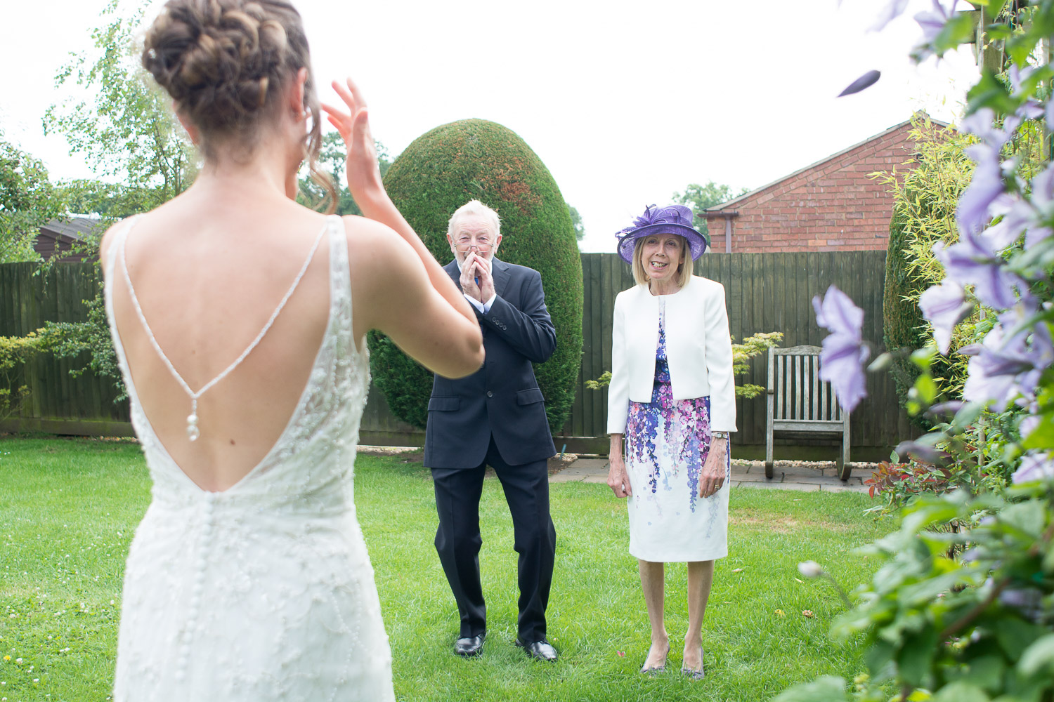 parents faces when they see their daughter in her wedding dress at wedding yurts wedding in leicestershire