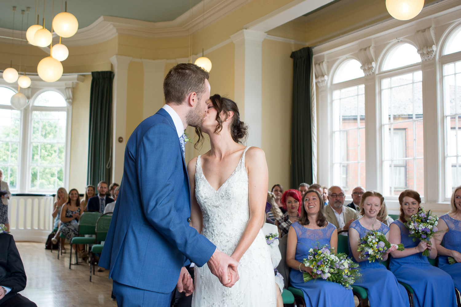bride and grooms first kiss at lutterworth town hall