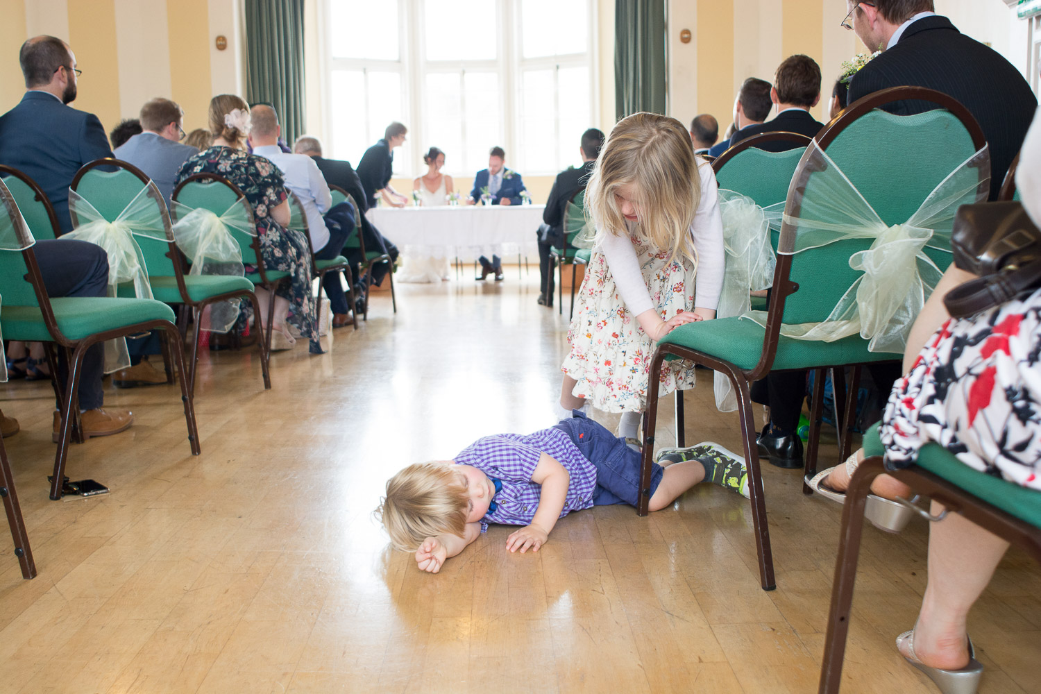 children lie down in the aisle at the lutterworth town hall