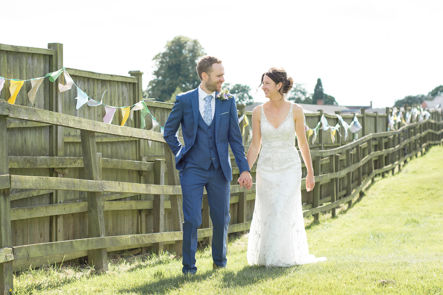 bride and groom walk together at wedding yurts wedding in leicestershire