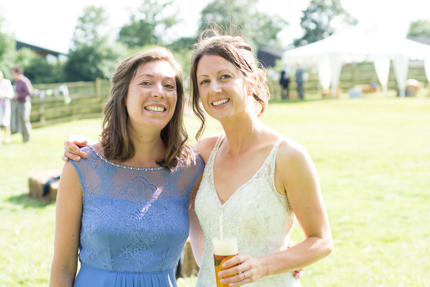 bride and bridesmaid at wedding yurts wedding in leicestershire