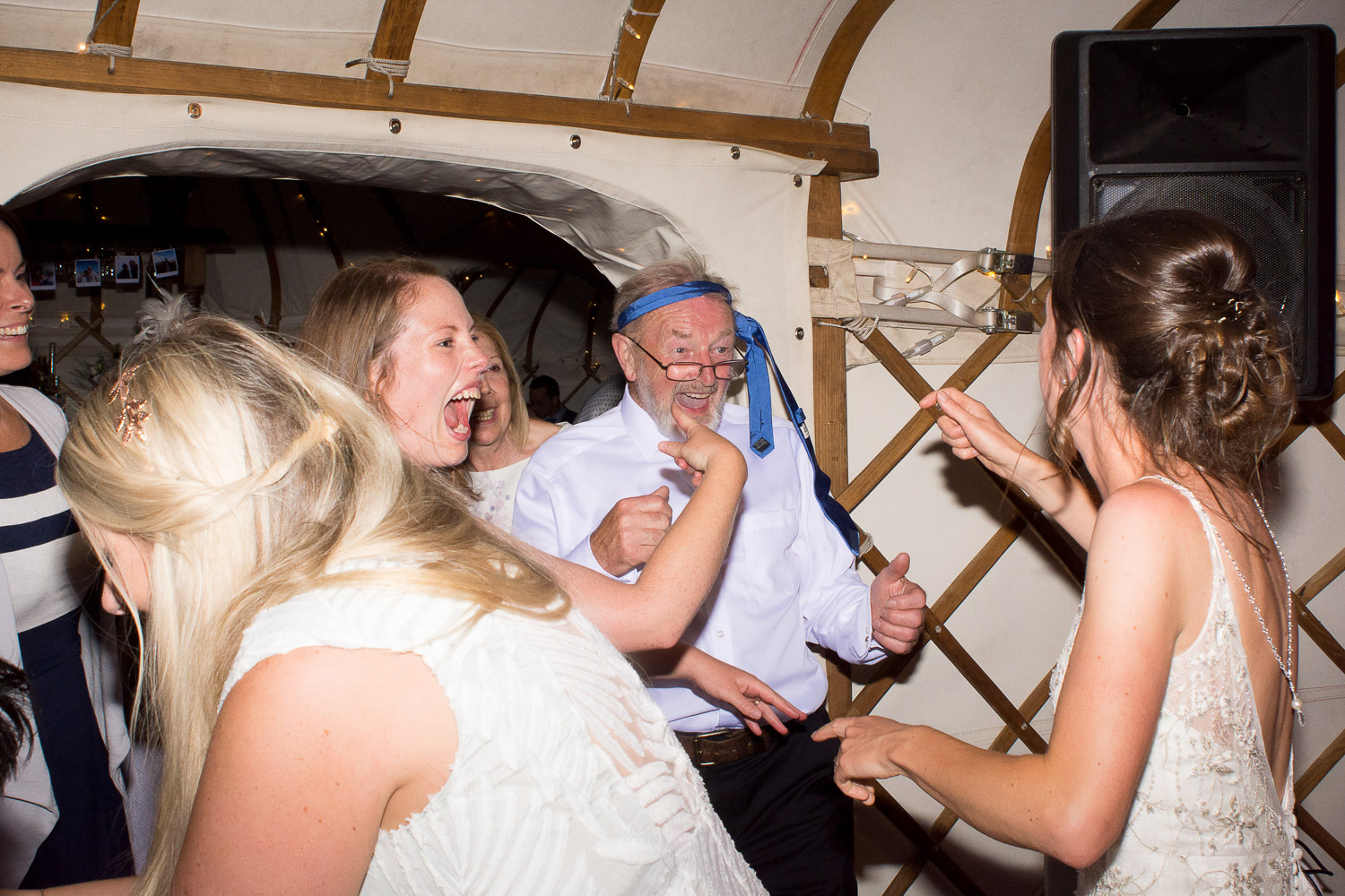 father of the bride with his tie on his head at wedding yurts wedding in leicestershire